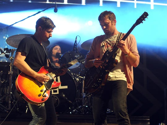 From left, Matthew Followill, Nathan Followill and Caleb Followill of Kings of Leon will headline on Sunday night at Chicago's Grant Park.