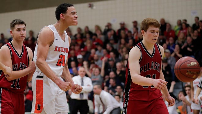 Kaukauna's Donovan Ivory (21) reacts after scoring a basket late in the second half against Pulaski in a WIAA Division 2 sectional semifinal game Thursday at Preble High School in Green Bay.