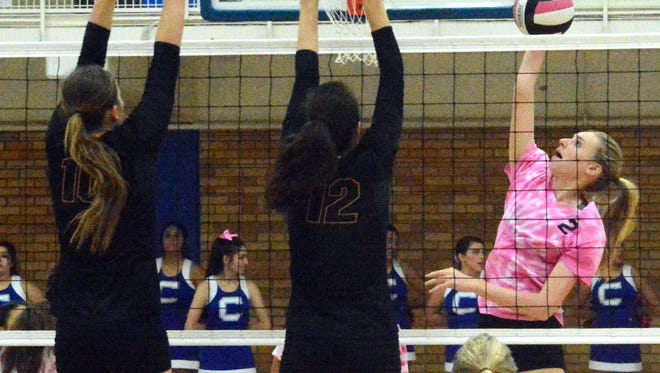 Carlsbad freshman middle blocker Carrie Lynn smashes the ball for a kill in the third set last Tuesday against Alamogordo. Carlsbad won in five sets Tuesday at Clovis.