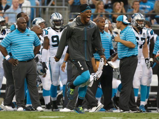 Carolina Panthers' Cam Newton, center, reacts after the defense stopped the Buffalo Bills on a goal line-stand during the first half of a preseason NFL football game in Charlotte, N.C., Friday, Aug. 8, 2014. (AP Photo/Bob Leverone)