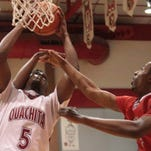Ouachita center Jay Head (5) helped Ouachita advance to the Class 5A quarterfinals with a win at Ruston on Tuesday.