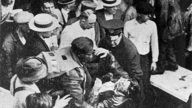 Garrett Morgan rescues a victim of the Waterworks Tunnel Disaster in July of 1916.
