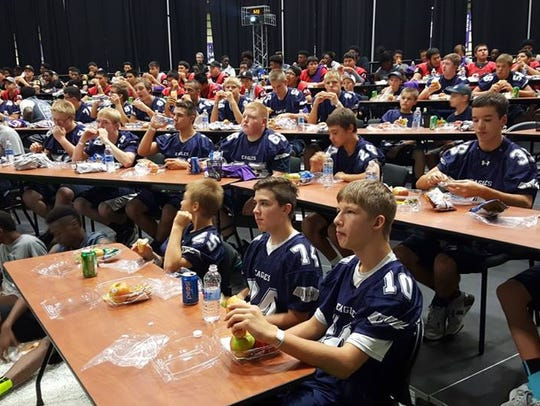 Eden Valley-Watkins football players, as well as players