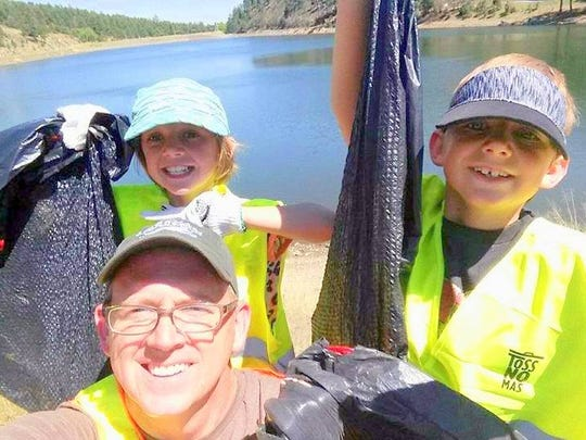 Tim Lewis and his children at Alto Lake won the photo
