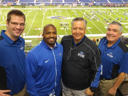 Voice of the Blue Raiders Chip Walters, second from