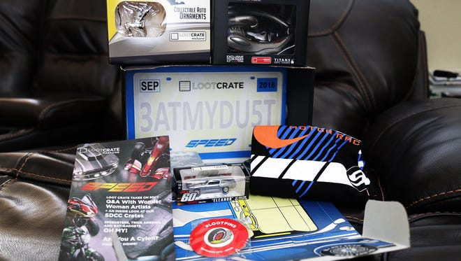 """This unboxing of the September 2016 """"Speed"""" themed Loot Crate includes a Tony Stark Racing shirt, Battlestar Galactica figure, Batjet key chain, Eleanor model and DC hood ornament."""