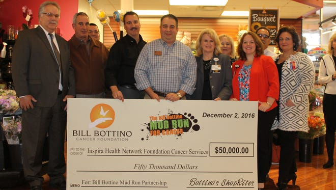 Members of the Inspira Health Network Foundation receive a $50,000 donation from the Bottino family's Bill Bottino Cancer Foundation.