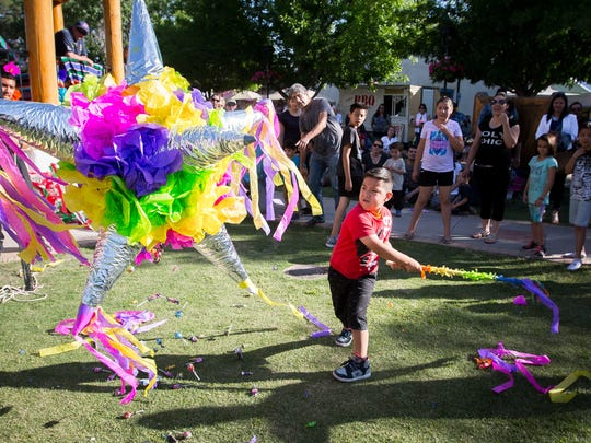 5-year-old Jesus Flores breaks open a piñata at Mesilla Plaza during the Cinco de Mayo fiesta, May 7, 2016.