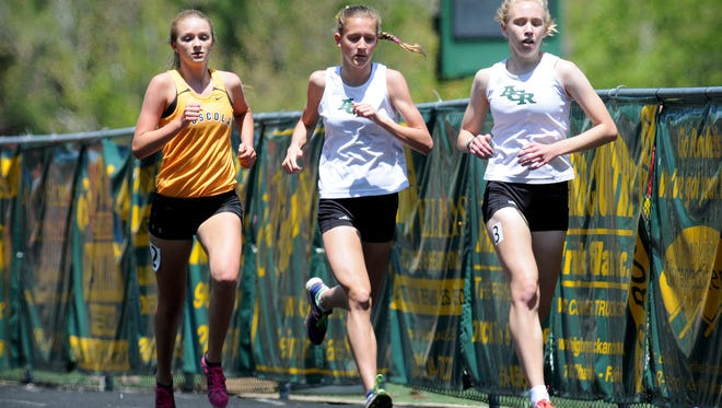 Reynolds junior Anna Vess, center, won three events at Saturday's 3-A Western Regional track meet.