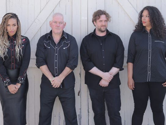 Welsh punk rocker Jon Langford (second from left) traveled