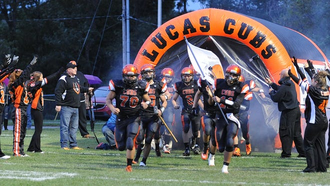 The Lucas Cubs storm the field before the start of their game with Loudonville earlier this season. Lucas will go to Danville in a game that pits the top two Division VII teams in the latest Ohio AP state poll that is for the Mid-Buckeye Conference championship.