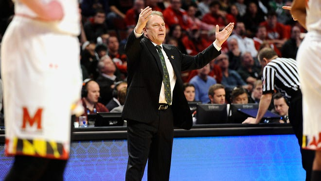 MSU's  Tom Izzo talks to his team after they took the lead then gave back some points against Maryland during their Big Ten Tournament game in Chicago on Saturday.