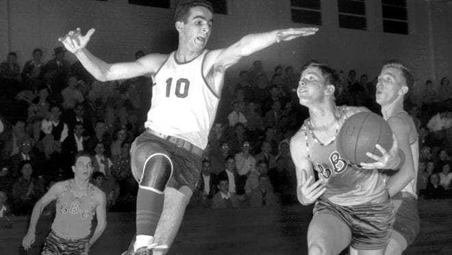January 16, 1951 - Lee Douty (#10) of Central is in position to successfully block Bill Schilling's attempted layup shot for CBC. Central's Richard Wright backs up the play at right as CBC's Skeeter Loeffel dashes in from the left in a vain effort to help. Central rallied to win 43-37 in January 1951.