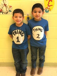 Tristan Buentello, 6, and Austin Lozano, 5, dress up