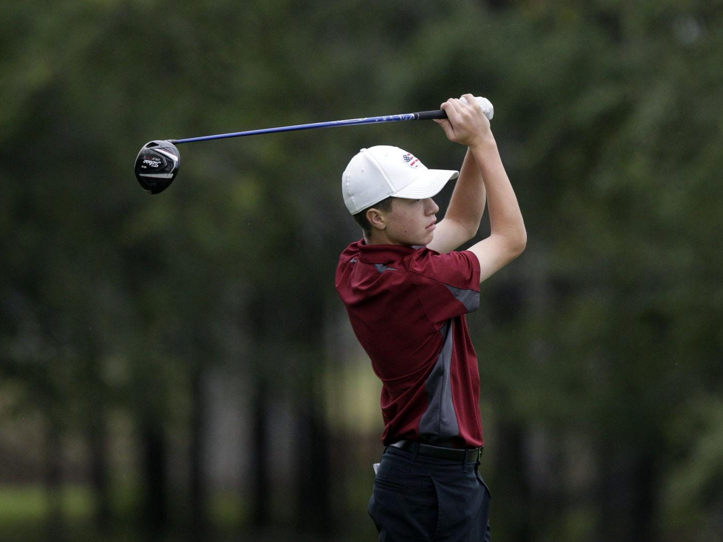 Roosevelt golfer Jack Lundin tees off on the first hole Tuesday during the Class AA state golf tournament at Meadowbrook Golf Course. Lundin won the individual crown with a two-day 146.
