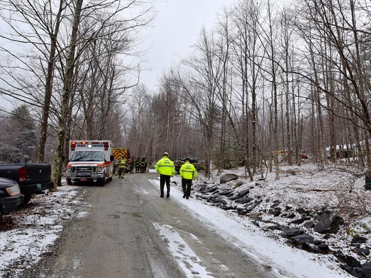 Rescue personnel and Vermont State Troopers gather