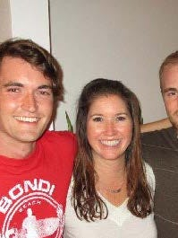 Undated photo shows Silk Road darknet founder Ross Ulbricht (left) with friends.