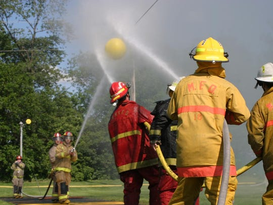 Rocky Ridge firefighters battle Sandusky Township firefighters in a game of waterball at a previous NOVFA Firemen's Convention in Clyde.