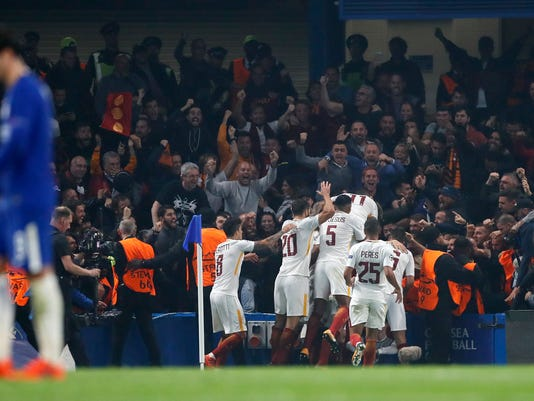 Roma's Edin Dzeko, unseen in the pictures celebrates with his teammates after scoring during the Champions League group C soccer match between Chelsea and Roma at Stamford Bridge stadium in London, Wednesday, Oct. 18, 2017. (AP Photo/Kirsty Wigglesworth)