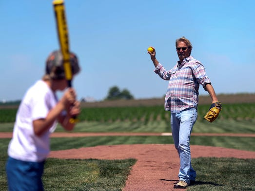 Actor Kevin Costner catches a ball while playing with his sons at the Field of Dreams movie site on Friday, June 13, 2014, outside Dyersville, Iowa. Costner is making a two-day appearance at the site in recognition of the 25th anniversary of the movie Field of Dreams.
