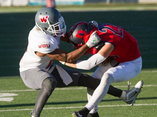 Dixie State wide receiver Nate Stephens fights for