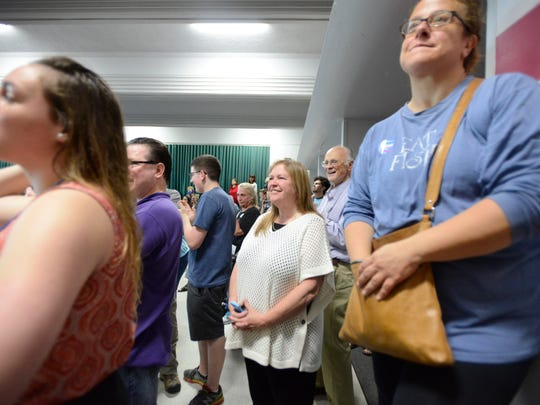 Jane Sanders stands among the Iowa City crowd and listens to her husband Bernie Sanders speak on Saturday morning, May 30, 2015.