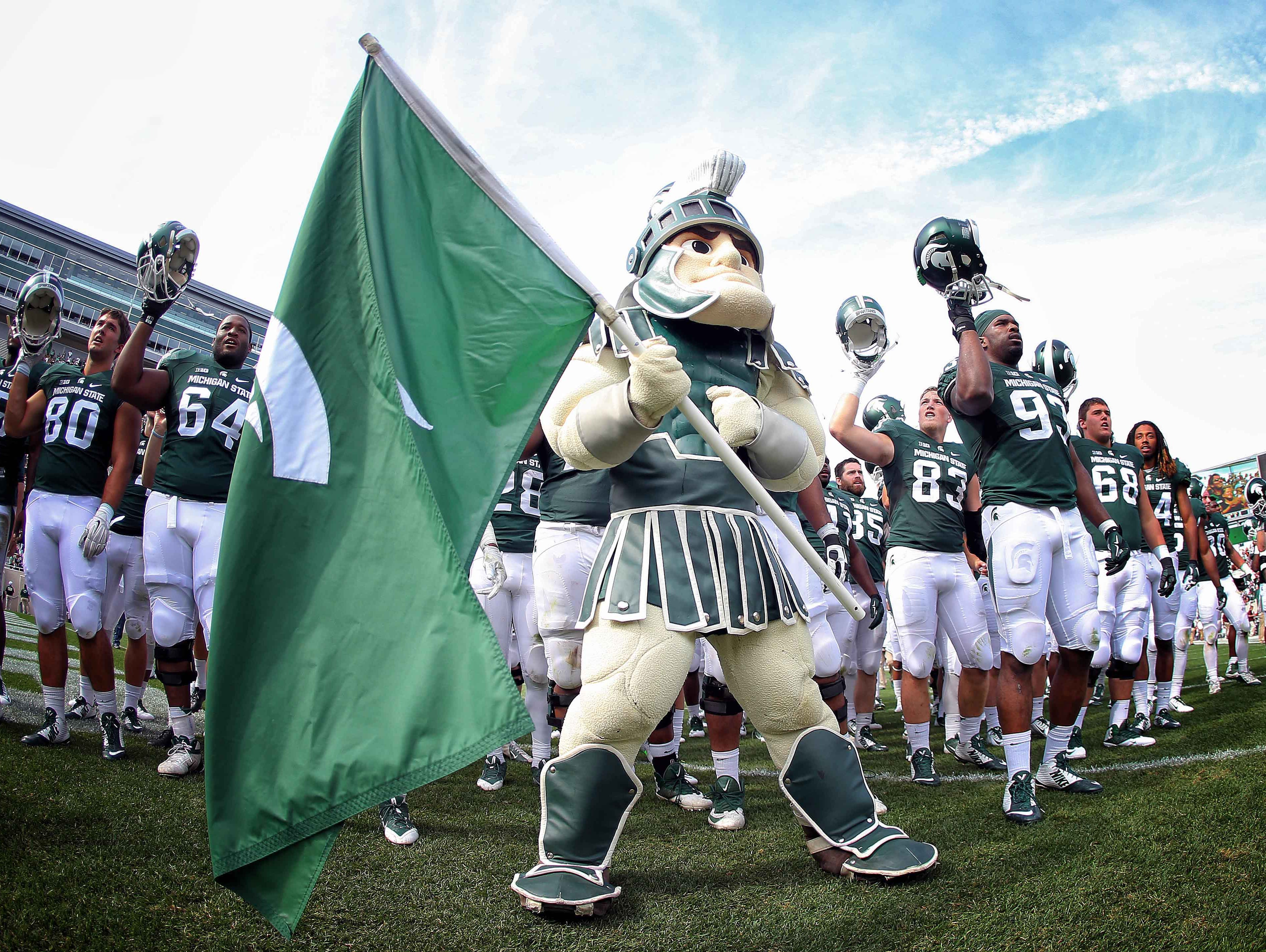 Sparty celebrates a win with the team after a game at Spartan Stadium.