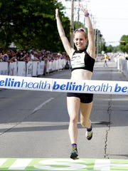 Kaitlin Gregg Goodman is the first female to cross the Bellin 10K Run finish line with a time of 34 minutes and 35 seconds on June 10, 2017 in Green Bay, Wis.