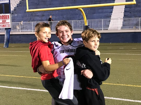 Jayce Harter poses with Justin Leathers, left, and Owen Blessinger, right, after Southridge defeated Mater Dei for the Class 2A Sectional 40 title.