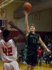 Kolten Sanford of North lets go of a floater over Nicely Tsianguebeni of Bosse during the first quarter of the game at Bosse in Evansville Saturday.