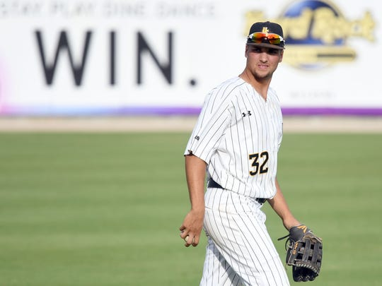 Southern Miss' Matt Wallner walks back to the filed