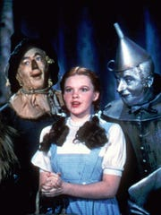 'The Wizard of Oz' starred Bert Lahr (from left) as the Cowardly Lion, Ray Bolger as the Scarecrow, Judy Garland as Dorothy, and Jack Haley as the Tin Woodman.