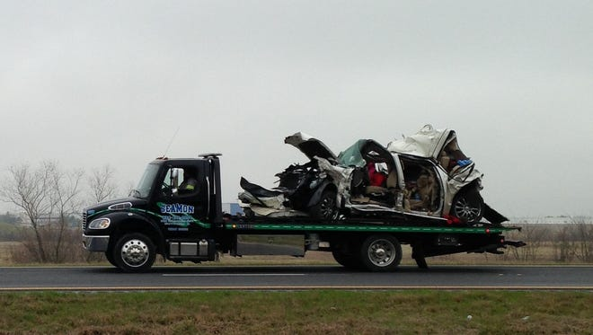 A car is hauled away from a multi-vehicle accident on Interstate 65.