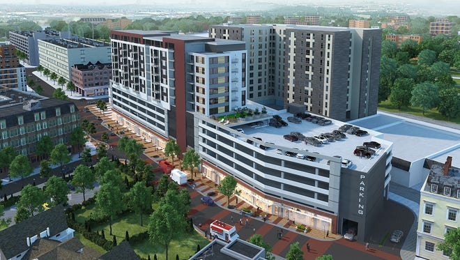 A rendering of the proposed City Center District showing Albert Avenue. The Albert Apartments and parking garage would be built on the site of City Lot 1 across from Harper's Restaurant and Brewpub. The Grand River Apartments tower would replace the buildings between Urban Outfitters and Lou & Harry's.