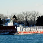 JEFFREY M. SMITH/TIMES HERALD Champion's Auto Ferry travels on the North Channel between Clay Township and Harsens Island.