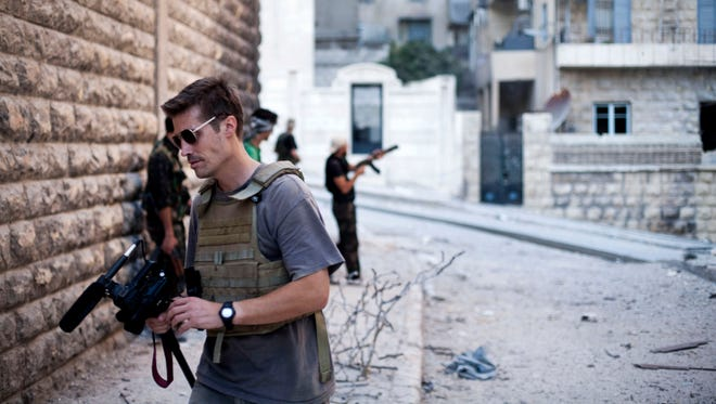 This September 2012 file photo posted on the website freejamesfoley.org shows journalist James Foley in Aleppo, Syria.In a horrifying act of revenge for U.S. airstrikes in northern Iraq, militants with the Islamic State extremist group have beheaded Foley ? and are threatening to kill another hostage, U.S. officials say.