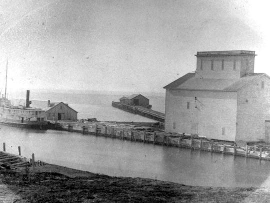Kirkland built the first grain elevator, seen here in 1865. He also extended the first pier to a length of 1,400 feet enabling ships to load on either side. The vessel seen here is the Messenger which carried flour from Sheboygan to Pentwater, Michigan and salt on the return trip.