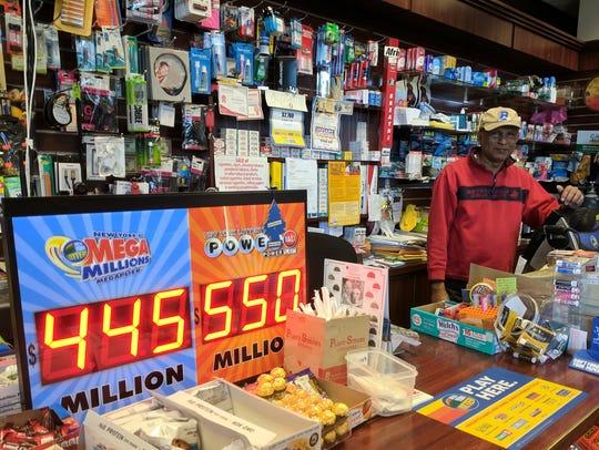 Al Prasad sells lottery tickets at his shop at 1133