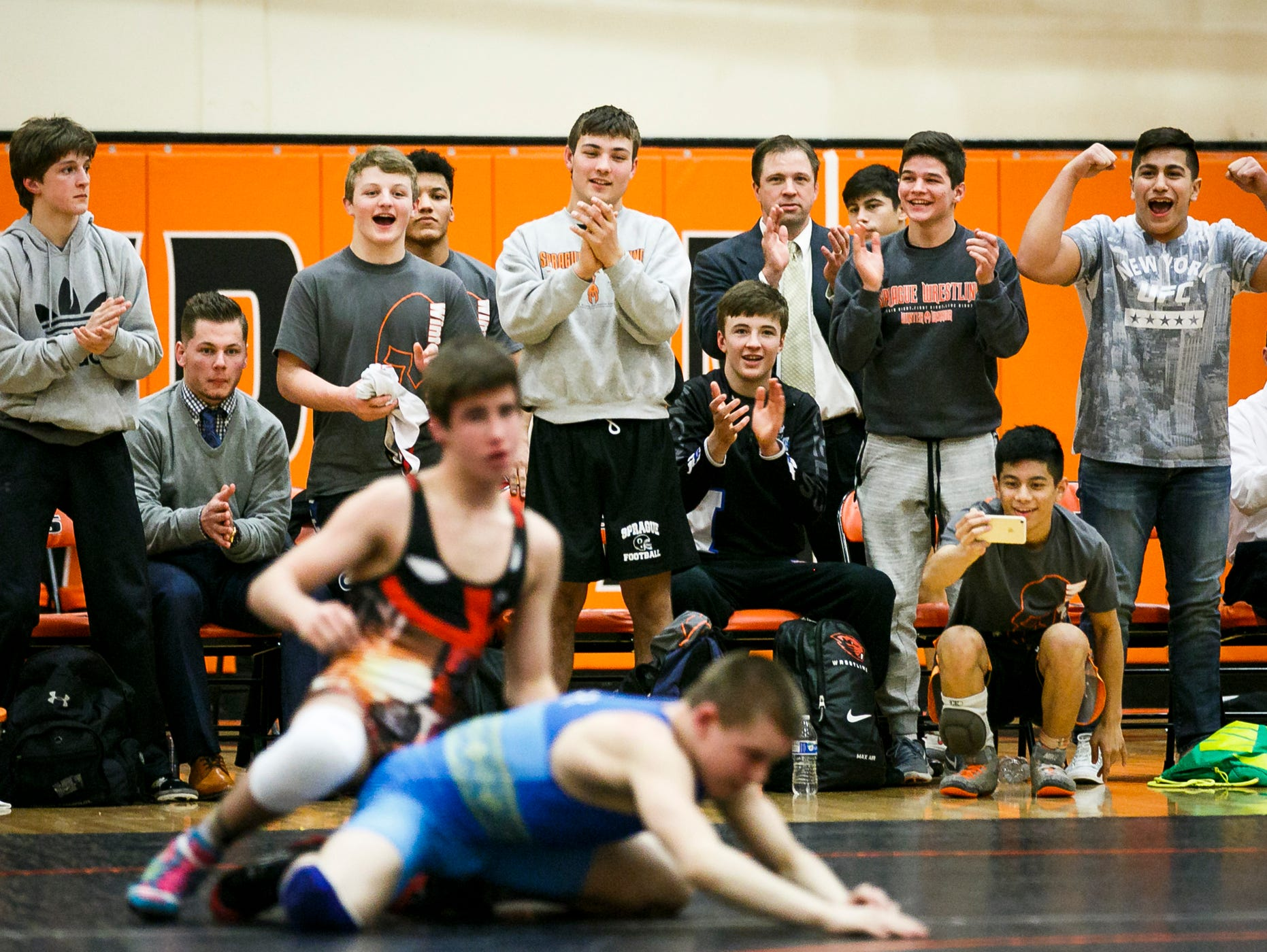Salem Area All-Star wrestlers cheer as Silverton's Kaden Kuenzi wins a match against Oleh Haider from Ukraine at Sprague High School on Tuesday, March 8, 2017. Kuenzi was the only Salem all-star athlete to win their match against the Ukrainian team; he said his previous experience with freestyle wrestling helped him in the match up.