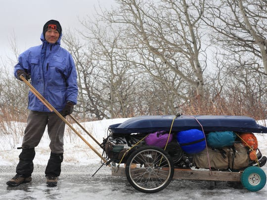 Sumio Harada heads out with the cart he uses to transport camera gear and equipment to film mountain goats.