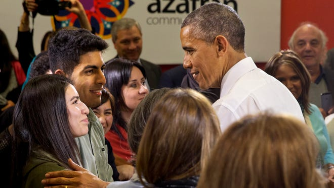 President Obama greets Elizabeth Narvaez-Vega, left, with Arturo Prieto-Valdez, both students at Glencliff High School in Nashville, after the president spoke about his recent executive actions on immigration at Casa Azafran in Nashville, Tenn., on Dec. 9, 2014.