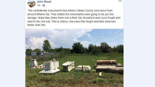 A photo posted to Facebook by John Wood shows the Athens Confederate monument stored in a field.
