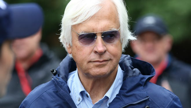Bob Baffert talks with the media before Justify took to the sloppy Pimlico surface.