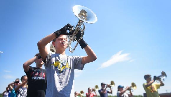 Mason LeMaster, freshman, practices playing the mellophone