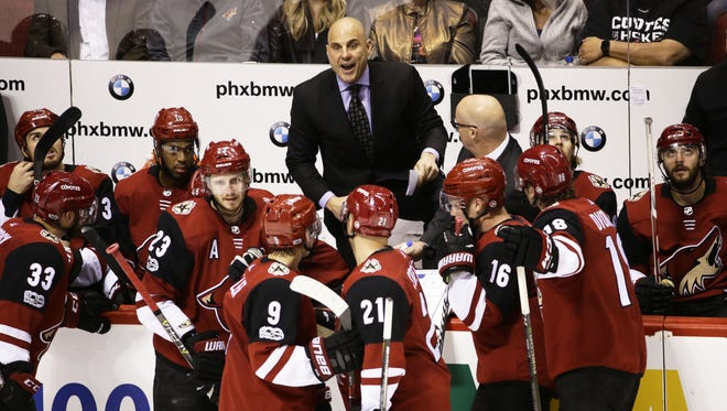 Coyotes head coach Rick Tocchet huddles with his players in the 3rd period on Oct. 19, 2017 at Gila River Arena in Glendale, Ariz. The Stars defeated Arizona 5-4.