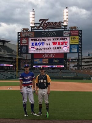 St. Clair graduate Gehrig Anglin and Port Huron Northern graduate Brett Manis stand together at Comerica Park.