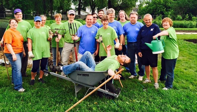 Sixteen Kohler associates recently gave their time to help Nourish in the gardens across from RCS Empowers.