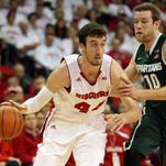 Wisconsin forward Frank Kaminsky (44) works the ball against Michigan State's Matt Costello (10) Sunday at Madison, Wis. Kaminsky had 31 points to lead the Badgers to victory.