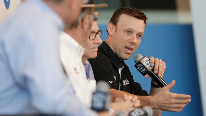 Flanked by team and sponsor representatives, Matt Kenseth answers questions during a news conference Wednesday in Charlotte, N.C., after his return to Roush Fenway Racing was announced.