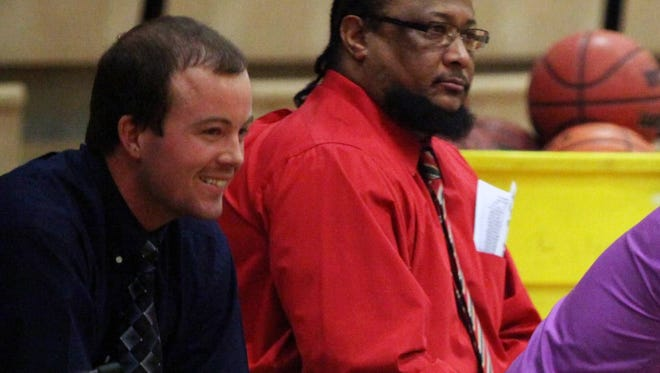 Brad DeWitt, left, smiles at his father, C. Jay DeWitt, Waynesboro's boys basketball head coach during the Little Giants' 2015-16 season. Brad, an assistant for his father for four years, was named head coach of Stuarts Draft's girls program on Wednesday.